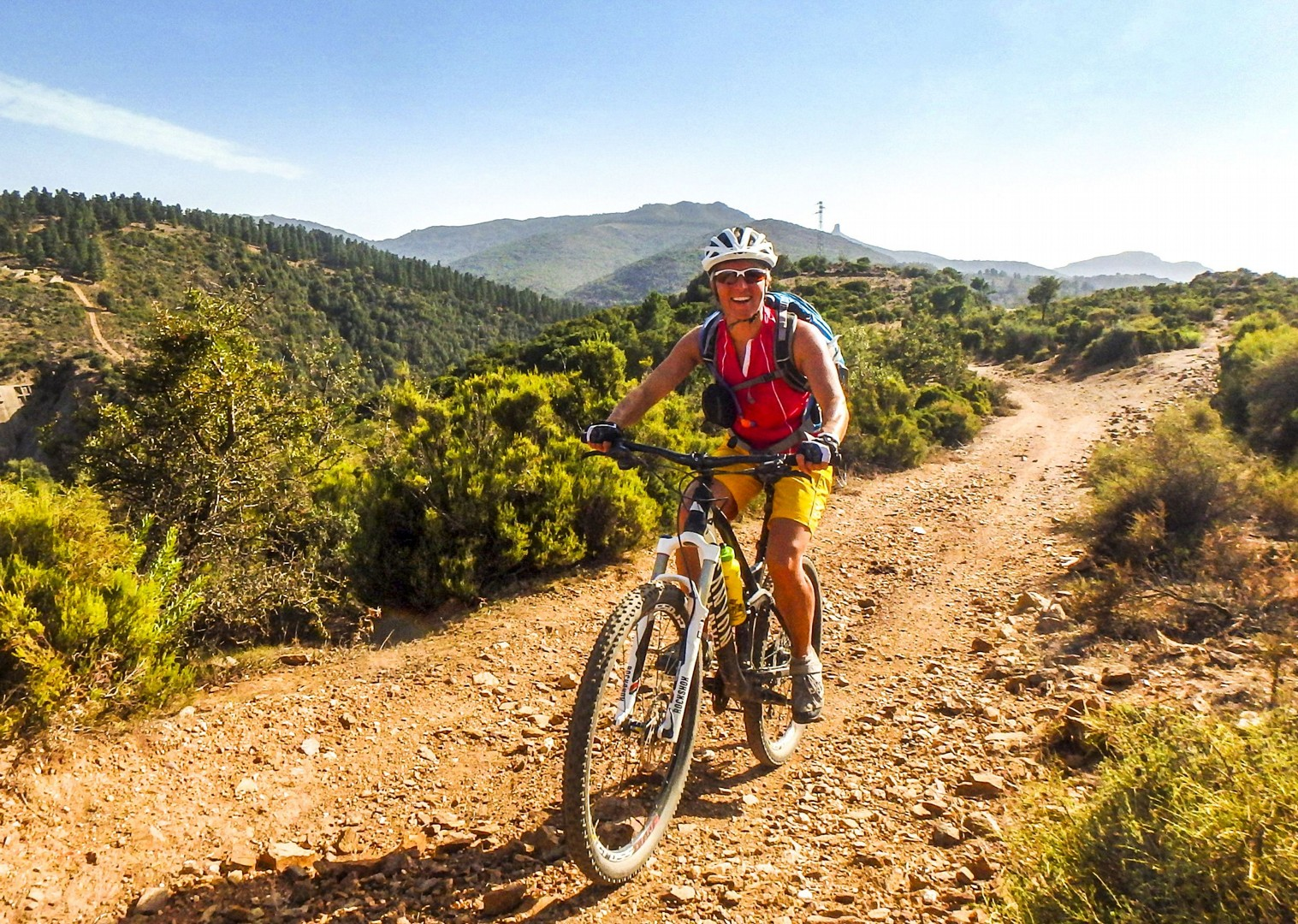woman-mountain-biking-saddle-skedaddle-sardinia-italy.jpg - Italy - Sardinia - Coast to Coast - Self-Guided Mountain Bike Holiday - Italia Mountain Biking