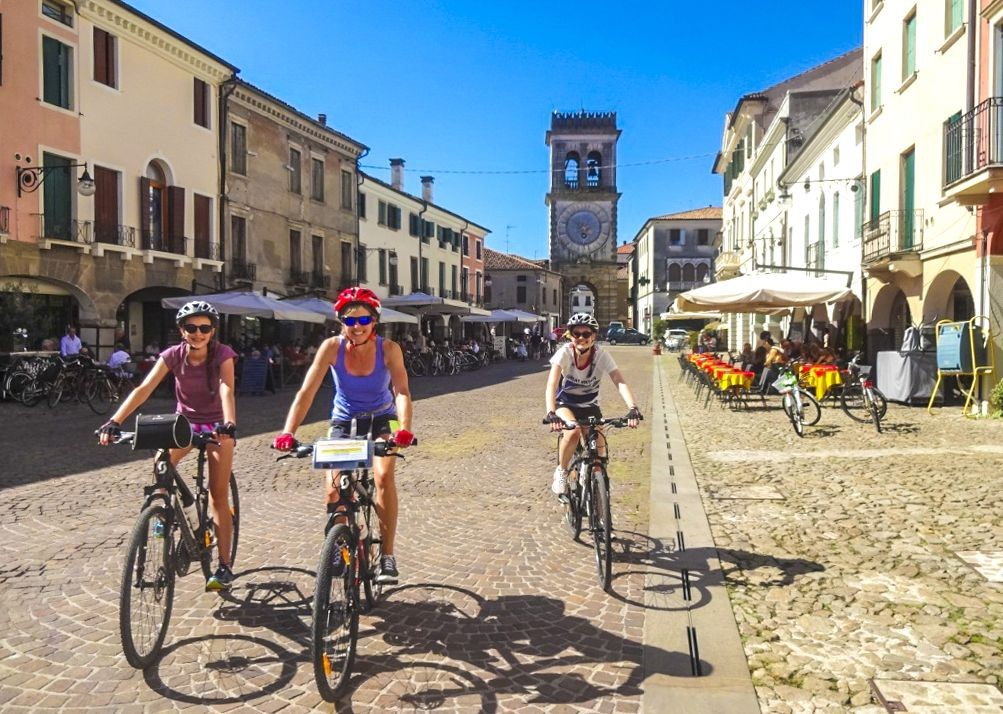 happy-cycling-fun-self-guided-traditional-italian-city.jpg - Italy - Lake Garda to Venice - Self-Guided Leisure Cycling Holiday - Italia Leisure and Family Cycling