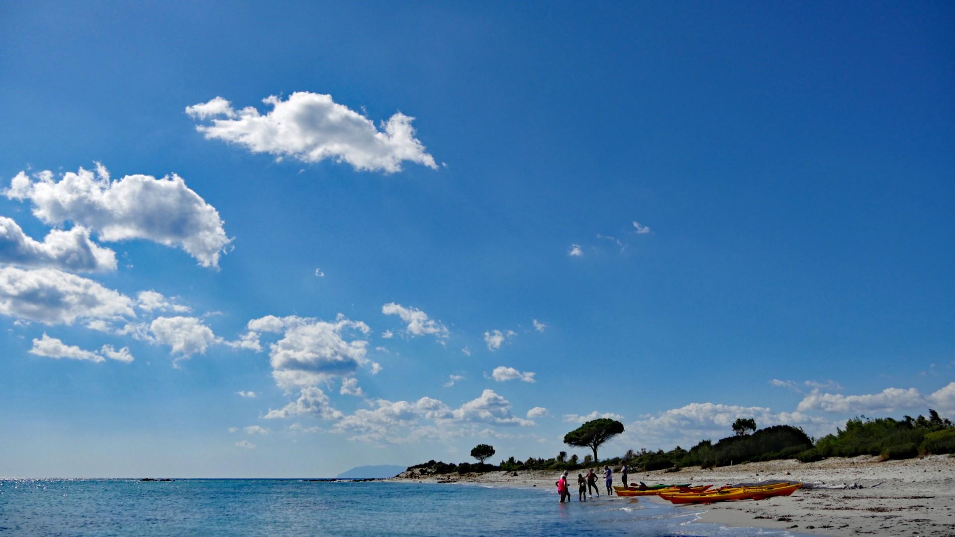 Spiaggia di Berchida - kayakers and a big sky view.jpg - Sardinia - Wilderness Blue Sea Kayaking - Kayaking