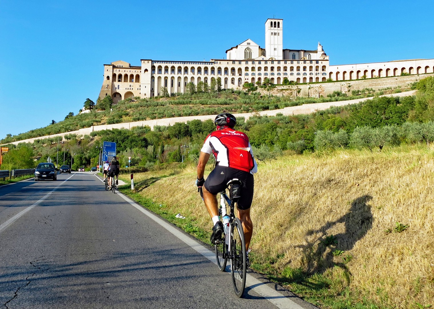 cycle-past-assisi-road-cycling-trip-italy.jpg - Italy - Grand Traverse - North to South - Guided Road Cycling Holiday (17 days) - Italia Road Cycling